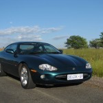 XK8 Parts - Bing Bergstedt Splendid Looking Metallic Aquamarine Car Crusing in the South African Outback